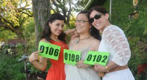 Ladies posing with bid numbers