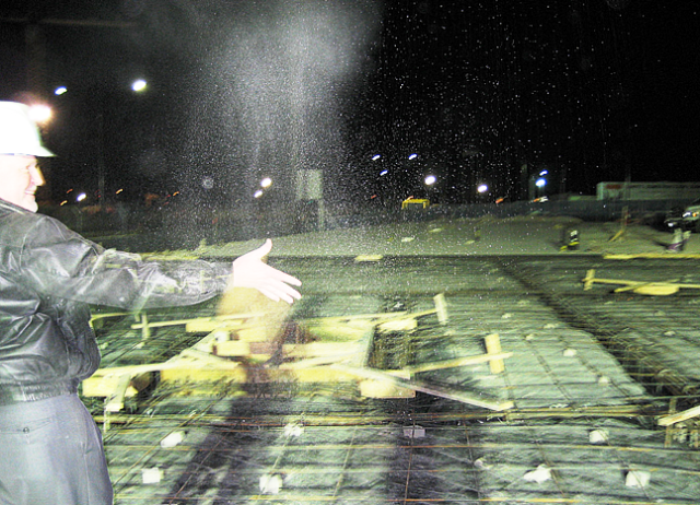 Pouring the foundation of the west wing at the new House early one morning in 2006.