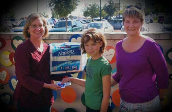 Claire Cabler, and her mother, Cynthia, donated $150, a $20 Wal-Mart Gift card and a huge package of napkins to RMHC Austin. I happily received Claire's donation.