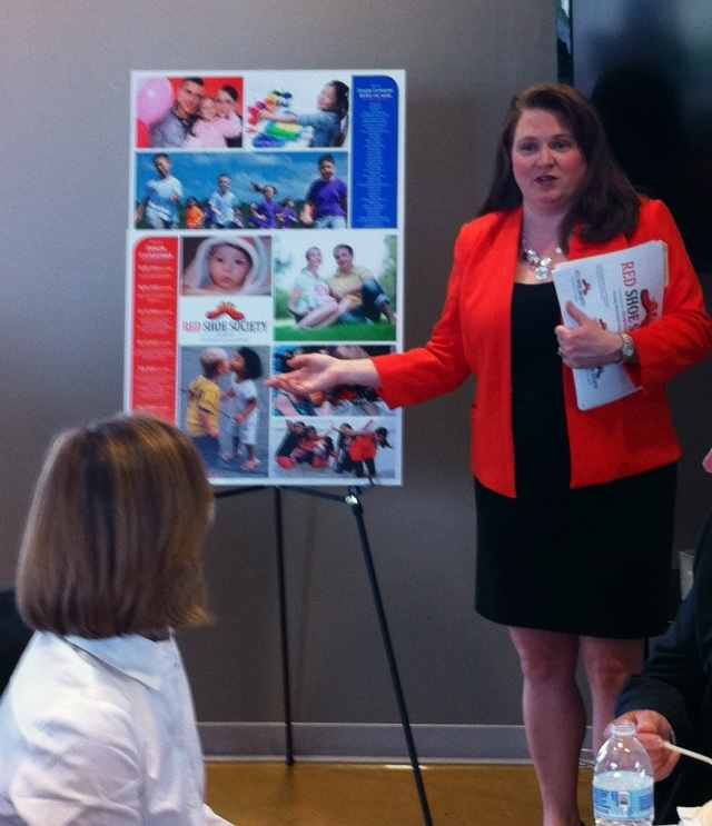 Jane Dueease describes the Red Shoe Society project to the RMHC Austin Board of Directors.
