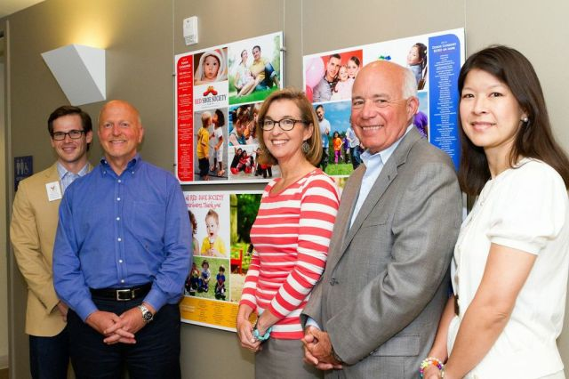 Patrick Ley, Kent Burress, Ann Jerome, Bob Shaver, Marian Wu - key board members and staff with our new Red Shoe Society donor wall.